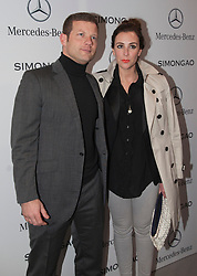 © Licensed to London News Pictures. 18 February 2014, London, England, UK. Pictured: Dermot O'Leary with wife Dee O'Leary. Celebrities attend the Mercedes-Benz sponsored SIMONGAO show during London Fashion Week AW14 at the BFC Courtyard Show Space/Somerset House. Photo credit: Bettina Strenske/LNP