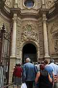 Tourists at the entrance to the cathedral church in city of Valencia, Spain