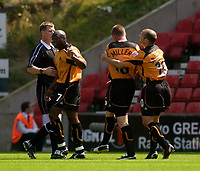 Photo. Glyn Thomas, Digitalsport<br /> Stoke City v Wolverhampton Wanderers. <br /> Coca Cola Championship. 08/08/2004.<br /> Wolves' Kenny Miller (second from R) aims a kick at teammate Shaun Newton but is restrained by Colin Cameron (R).