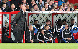 Both managers look on during the game - Photo mandatory by-line: Robin White/JMP - Tel: Mobile: 07966 386802 21/10/2013 - SPORT - FOOTBALL - Selhurst Park - London - Crystal Palace V Fulham - Barclays Premier League