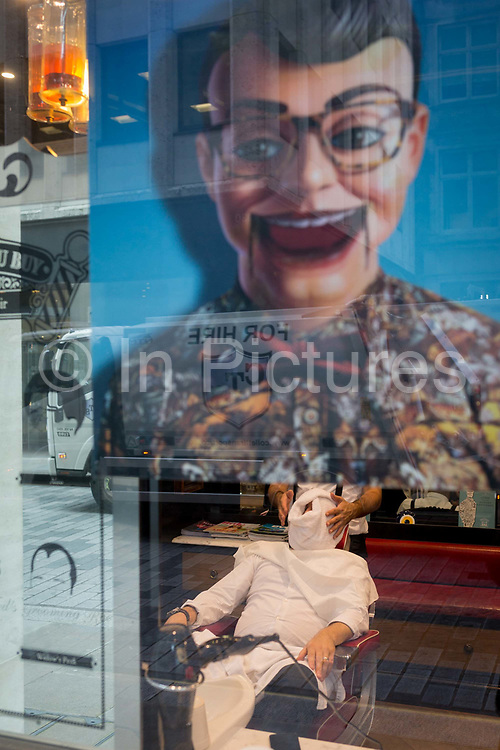 A businessman has a hot towel massage in a barbers chair in the grooming room at the rear of clothing retailer, Ted Baker London, on 14th September 2017, in the City of London, England.
