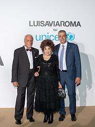 Giacomo Guerrera, Gina Lollobrigida, Paolo Rozera arriving at a photocall for the Unicef Summer Gala Presented by Luisaviaroma at Villa Violina on August 10, 2018 in Porto Cervo, Italy. Photo by Alessandro Tocco/ABACAPRESS.COM