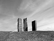 Protest står på Hakberget på Gärdet. Skulpturen består av höga stenblock i röd grovhuggen granit, det mellersta utformat som en knytnäve, symbolen för kampen om ett rättvist samhälle. Platsen var mål för 1 maj-demonstrationer mellan 1890 och 1965.
