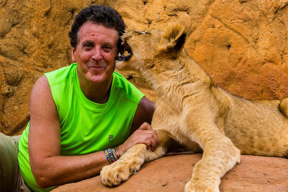 Blaine Harrington with a 4 month old Lion Cub, Lion Park, near Johannesburg, South Africa.