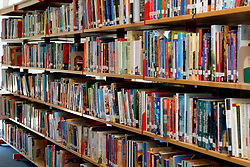 Rows of books in school library London UK