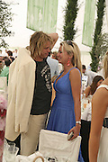 Sam Branson and Holly Branson, Cartier International Polo. Guards Polo Club. Windsor Great Park. 30 July 2006. ONE TIME USE ONLY - DO NOT ARCHIVE  © Copyright Photograph by Dafydd Jones 66 Stockwell Park Rd. London SW9 0DA Tel 020 7733 0108 www.dafjones.com