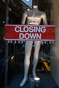 "An announcement banner of a business' imminent closure is in the window of a Rio Beach clothing outlet on a fashion mannequin in their Earlham Street shop. Their web site says: ""Rio Beach sells men's clothing for the beach and beyond. As one of the only places that stocks fashionable swimming trunks year round, this is a useful place if you're planning an unseasonable holiday."""