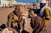 Market trader selling khat. Chewing khat is common amongst people in the region. Users claim it is a stimulant giving a sense of well being, allertnes sand excitement. Tadjoura, Djibouti. Tadjura is the oldest town in Djibouti and the third largest city in the country with a population of some 25,000.
