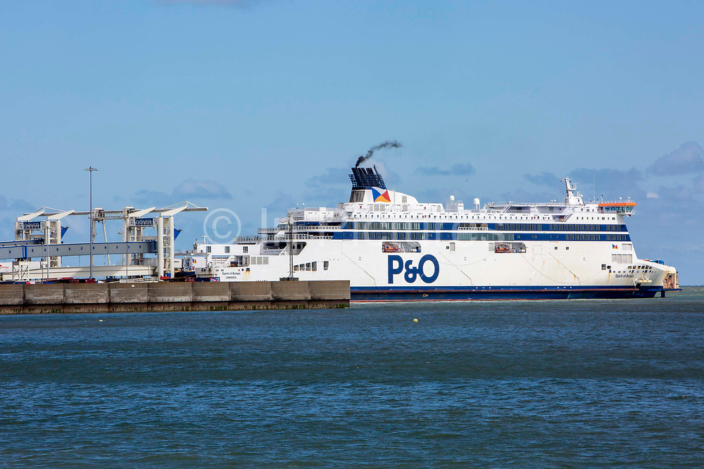 As P&O Ferries announce 1100 UK job losses after taking advantage of the governments furlough scheme due to the COVID - 19 outbreak, a P&O ferry in the Eastern Dock of the Port of Dover is where the cross channel port is situated with ferries departing here to go to Calais in France, on the 13th of May 2020 in Dover, Kent, United Kingdom. Dover is the nearest port to France with just 34 kilometres 21 miles between them. It is one of the busiest ports in the world. As well as freight container ships it is also the main port for P&O and DFDS Seaways ferries.