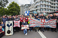 Veterans against terrorism banner/flag during the Football Lads Alliance march between Park Lane and Westminster Bridge, London on 7 October 2017. Photo by Phil Duncan.