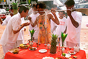 THAILAND, PHUKET ISLAND Chinese Vegetarian Festival, followers (considered spirit mediums in trance) do body piercing and bless offerings