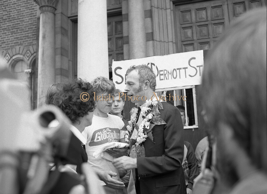 """Fr Niall O'Brien Returns from Captivity.1984..14.07.1984..07.14.1984..On 6 May 1983,Fr Niall O'Brien was arrested along with two other priests, Fr. Brian Gore, an Australian, Fr. Vicente Dangan, a Filipino and six lay workers - the so-called """"Negros Nine"""", for the murders of Mayor Pablo Sola of Kabankalan and four companions. The priests where held under house arrest for eight months but """"escaped"""" to prison in Bacolod City, the provincial capital, where they felt they would be safer.The case received widespread publicity in Ireland and Australia, the home of one of the co-accused priests, Fr. Brian Gore. When Ronald Reagan visited Ireland in 1984, he was asked on Irish TV how he could help the missionary priest's situation. A phone call the next day from the Reagan administration to Ferdinand Marcos resulted in Marcos offering a pardon to Fr. O'Brien and his co-accused..(Ref Wikipedia)...Fr O'Brien is welcomed after his """"Release"""" from Sean McDermott Street Jail"""