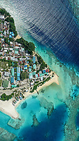 Aerial view of the local island Keyodhoo, Vaavu Atoll, Maldives, Indian Ocean with reef, shipyard. bikini  / guest beach and houses