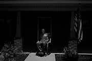 """BIRMINGHAM, AL – JUNE 13, 2015: Matthew Seals, 47, sits with his mail on his front porch in the Winchester Hills neighborhood. <br /> <br /> In April 1998, a deadly F5 tornado ripped through the suburbs of Birmingham, Alabama, killing 32 people and destroying hundreds of homes. Seventeen years later, Matthew Seals is still learning to cope with the loss of his youngest son, who was killed in the storm. With help from Habitat for Humanity, Seals completed construction on a new home in 2015, where he continues to raise his remaining children and his new life as a paraplegic. Despite his own suffering from the tragedy, Seals volunteers with Habitat to help other families find their own form of stability through home ownership. """"Habitat gives you an opportunity to help yourself,"""" Seals said. """"Not just for the immediate need, but for the long term to become more self-sufficient, more self-confident, and more self-reliant."""""""