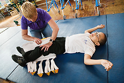Boy with cerebral palsy using therapeutic leg gaiters,