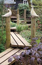 Wooden boardwalk through a shady woodland area at Barleywood in spring