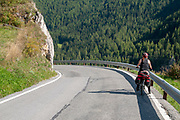 Woman Cycling the Inn river path, Near Guarda, Graubuenden, Switzerland