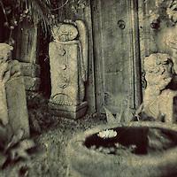 Texture treated photo of an outdoor sculpture garden with an Asian spiritual theme.