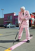 """The KFC Colonel Bob Thompson helps as a Louisville, Ky., KFC restaurant """"goes pink"""" Friday, April 9, 2010, to help launch the brand's new Buckets For a Cure(TM) campaign, aimed at raising both money and awareness for breast cancer.  For the first time in the brand's 70-year history, KFC's iconic buckets will change color this month, along with their global """"White House"""" headquarters, as part of a brand-wide pink makeover to support Susan G. Komen for the Cure®. (Photo by Brian Bohannon)"""