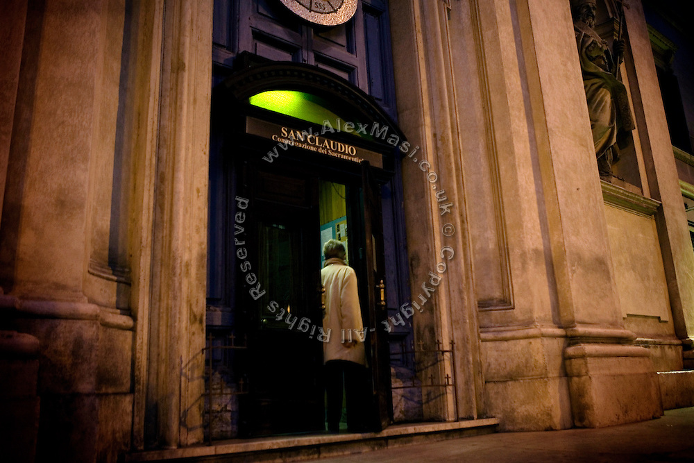 A lone woman is entering The Church of San Claudio, in Rome, Italy, where Father Igino Troiani, 77, normally carries out exorcisms. He has been an exorcist for around five years.<br /> <br /> FOR MORE INFORMATION PLEASE WRITE TO ALEX@ALEXMASI.CO.UK<br /> <br /> **TEXT AND LENGHTY INTERVIEWS AVAILABLE**