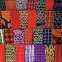 Africa, Kenya, Maasai Mara. A colorful display of fabrics and cloth of the Maasai people at Olanana in the Maasai Mara.