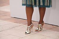 Actress Octavia Spencer wearing gold high heeled sandals at the Fruitvale Station film photocall at the Cannes Film Festival 16th May 2013