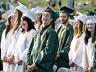 Nick Garafalo, center, and other Minisink Valley seniors laugh during the start of graduation ceremonies on the football field on Friday, June 21, 2013.