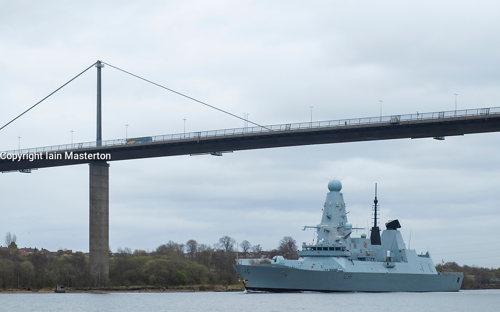 Erskine, Scotland, UK. 26 March, 2019. HMS Defender, a Type 45 Destroyer, leaves Glasgow and sails to sea on the River Clyde under the Erskine Bridge after her first home visit in 5 years. Built at Govan on the Clyde,  HMS Defender will now join Exercise Joint Warrior, a multi national military exercise off the west coast of Scotland.