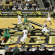 Central Florida forward Keith Clanton (33) dribbles the ball during a Conference USA NCAA basketball game between the Marshall Thundering Herd and the Central Florida Knights at the UCF Arena on January 5, 2011 in Orlando, Florida. Central Florida won the game 65-58 and extended their record to 14-0.  (AP Photo/Alex Menendez)