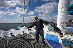 Sami Al Shukaili (OMA) coils a mooring line on Oman Sail's MOD70 Musandam during Kiel week 2014, 22-06-2014, Kiel - Germany.