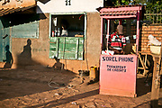 A street vendor, at right, sells phone cards in his stand in a market area in Bangui.