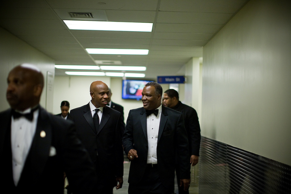 NATIONAL HARBOR, MD - DECEMBER 6: Prince George's County Executive-Elect Rushern Baker III, accompanied by his security detail and Martin K. Olagbegi (right), walks through the basement halls to get to his next destination during the inaugural ball at Gaylord National Convention on December 6, 2010 in National Harbor, Maryland. (Photo by Michael Starghill, Jr.)