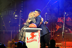 © Licensed to London News Pictures. 15/11/2013<br /> Tamera Foster hugs Jahmene Douglas<br /> Bluewater,Kent. Christmas Light switch tonight (15.11.2013)<br /> with  Toby Antis, Justin Fletcher (Mr Tumble), Jahmene Douglas and X- factors Tamera Foster from this years show.<br /> Photo credit :LNP