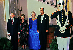 United States President George H.W. Bush, right, and President Mikhail Gorbachev of the Union of Soviet Socialist Republics, left, pose for a group photo with their wives in front of the Grand Staircase of the White House in Washington, DC prior to a state dinner on Thursday, May 31, 1990. From left to right: President Gorbachev, Raisa Gorbachev, first lady Barbara Bush, and President Bush. Photo by Dennis Brack / Pool via CNP /ABACAPRESS.COM