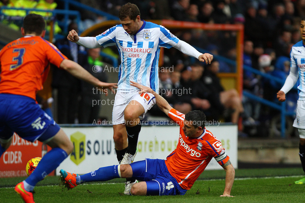 Paul Robinson of Birmingham City tackles Grant Holt of Huddersfield Town. Skybet football league championship match, Huddersfield Town v Birmingham city at the John Smith's stadium in Huddersfield, Yorkshire on Saturday 20th December 2014.<br /> pic by Chris Stading, Andrew Orchard sports photography.