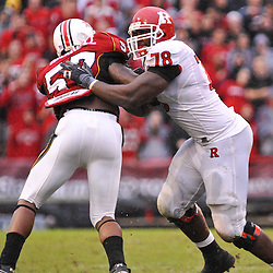 Sep 26, 2009; College Park, MD, USA; Rutgers offensive lineman Kevin Haslam (78) blocks Maryland defensive lineman Jared Harrell (57) during the second half of Rutgers' 34-13 victory over Maryland in NCAA college football at Byrd Stadium.