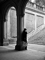 Girl with a cell phone at Bethesda Terrace in Central Park, New York City.