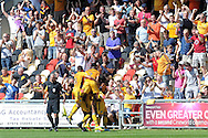 Jack Compton of Newport county (hidden) celebrates with his teammates and fans after he scores his teams 1st goal to equalise against Mansfield. Skybet EFL league two match, Newport county v Mansfield Town at Rodney Parade in Newport, South Wales on Saturday 6th August 2016.<br /> pic by Carl Robertson, Andrew Orchard sports photography.