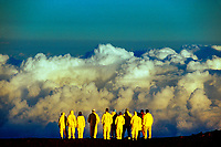 A bicycle tour group ontop of Haleakala at sunrise overlook the clouds, Haleakala National Park, Maui, Hawaii USA