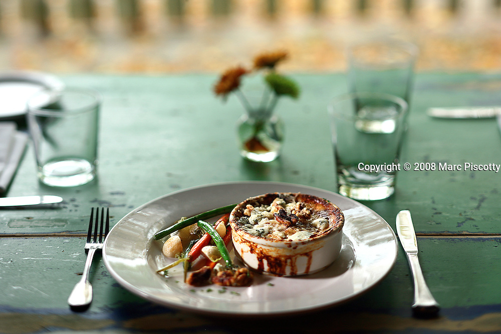 SHOT 10/2/08 5:41:56 PM - The butternut squash and blue cheese gratin by chef Dustin Barrett of Tables Restaurant in the Parkhill neighboirhood of Denver, Co. Barrett co-owns the restaurant with his wife Amy Vitale. The item isn't on the menu at Tables but something Barrett has made for family during the Holidays..(Photo by Marc Piscotty / © 2008)