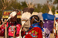 Traditional dancers at Crow Fair powwow with eagle fans, Crow Indian Reservation, Montana