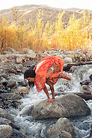 """Woman outdoors in yoga pose bakasana in a mountain river.<br /> :::<br /> """"Yoga techniques aren't ideals to be mastered but rather launching pads for deeper exploration of the energy that flows through the body, mind, breath and cosmos""""<br /> -Claudia Cummins Yoga"""