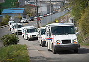 A funeral procession for U.S. Postal Service worker Judy Doran is led by mail carrier vehicles on May 9, 2020 as it arrives at Bayview Cemetery in Ketchikan, Alaska. Judy Ann Doran, 58, was a 16-year employee of the U.S. Postal Service and died on April 23 in Bellingham, Wash.