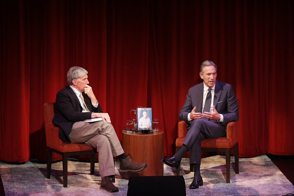"""From left: Moderator Roy Eisenhardt hosts former Starbucks CEO Howard Schultz during a program at the Jewish Community Center on Friday, Feb. 1, 2019, in San Francisco, Calif. Schultz promoted his new book, """"From the Ground Up: A Journey to Reimagine the Promise of America."""""""