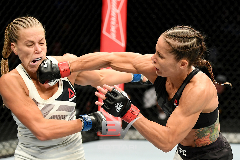 NEW YORK, NY - NOVEMBER 12: Liz Carmouche of the United States (left) lands a punch on Katlyn Chookagian of the United States in their women's bantamweight bout during the UFC 205 event at Madison Square Garden on November 12, 2016 in New York City.  (Photo by Jeff Bottari/Zuffa LLC/Zuffa LLC via Getty Images)