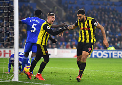 Watford's Troy Deeney (right) celebrates scoring his side's fourth goal of the game with team-mate Gerard Deulofeu during the Premier League match at the Cardiff City Stadium.