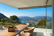 beautiful veranda with wooden table and wicker chairs, <br /> panoramic view