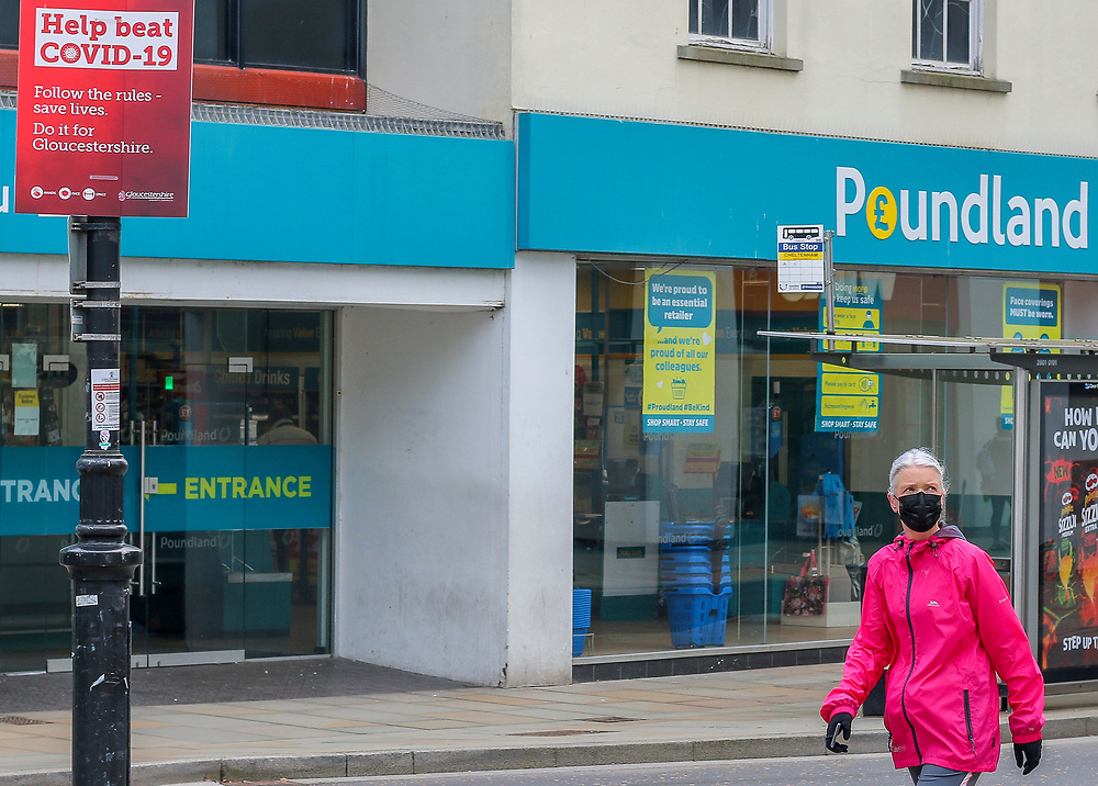 1st March, Cheltenham, England. A woman walking through the town centre in Cheltenham wearing a mask during England's third national lockdown.
