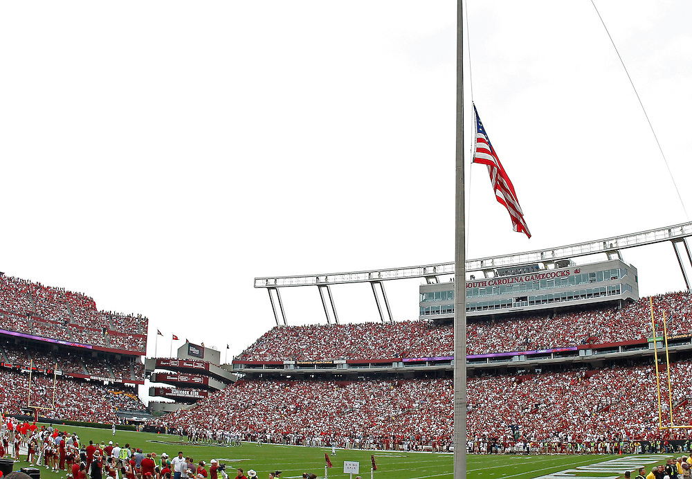 COLUMBIA - SEPTEMBER 11:  The United States of America flag hangs at half mast during the game between the Georgia Bulldogs and the South Carolina Gamecocks at Williams-Brice Stadium on September 11, 2010 in Columbia, South Carolina.  The Gamecocks beat the Bulldogs 17-6.  (Photo by Mike Zarrilli/Getty Images)