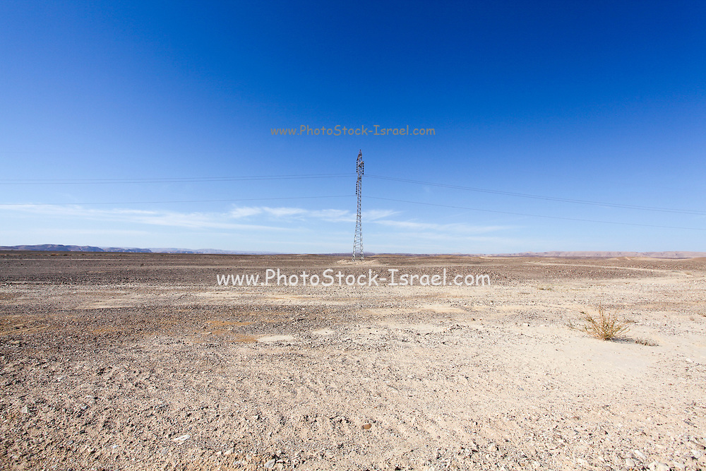 Electricity pylon and power lines in desert. Photographed in the Negev Desert. Israel